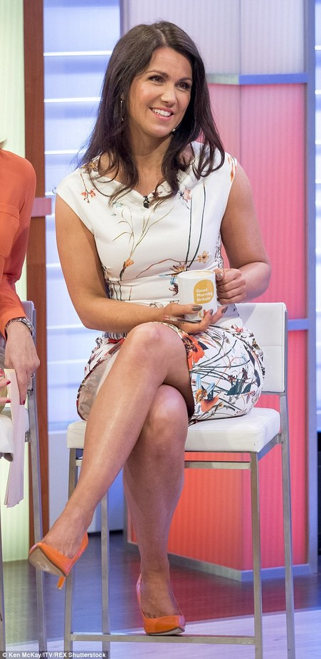 Susanna Reid wore a summery floral dress with bright orange heels while on the set of Good Morning Britain on Monday